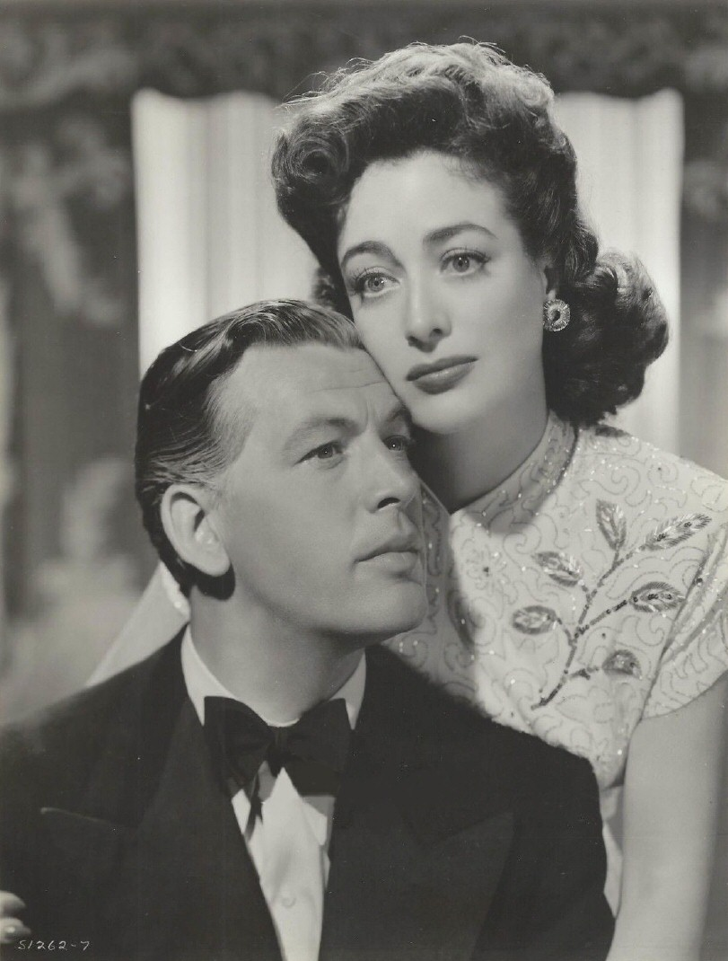 1942. 'Reunion in France' publicity with Philip Dorn.