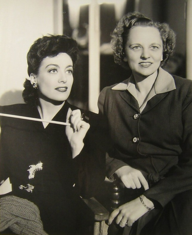 1942. On the set of 'They All Kissed the Bride' with secretary Almeda Dewey.
