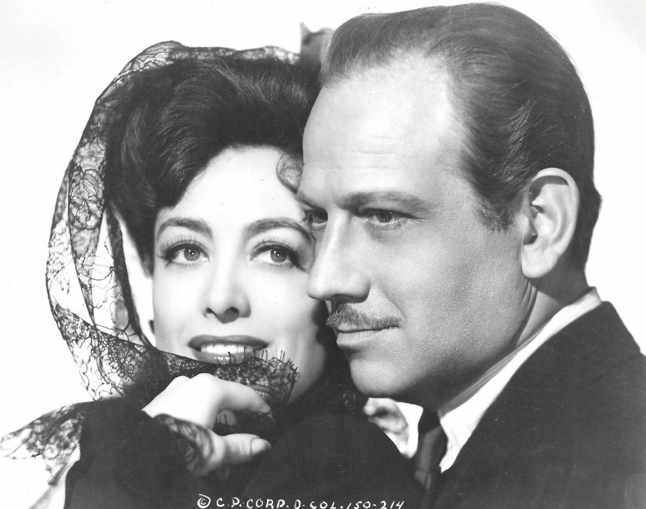 1942. Publicity for 'They All Kissed the Bride,' with Melvyn Douglas.