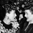 1945. At a Warners reception for Joan at NYC's Sherry-Netherland. With the Andrews Sisters.