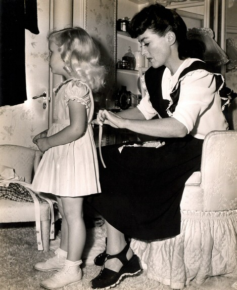 1943. Joan and Tina at home.