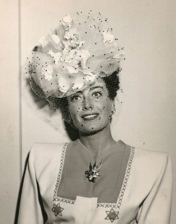 May 1945, at the Beverly Wilshire. Hat by Walter Florell.