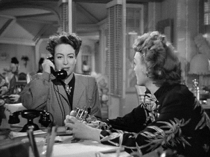1945. 'Mildred Pierce' screen shot with Eve Arden.