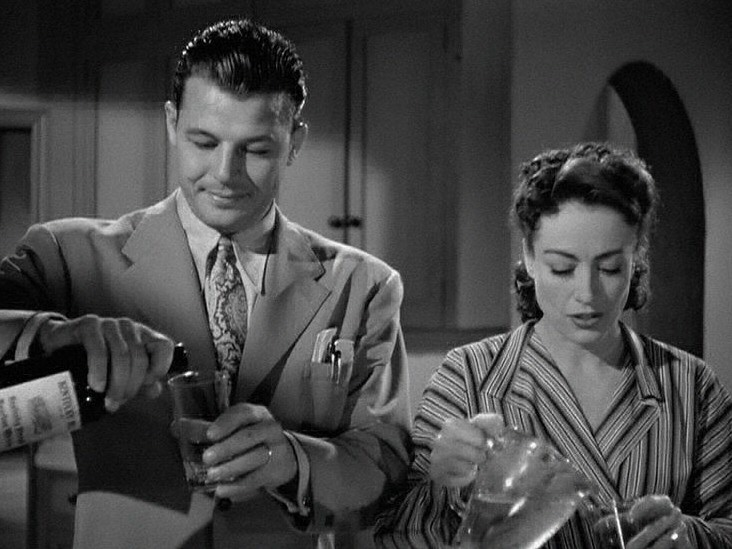 1945. 'Mildred Pierce' screen shot with Jack Carson.