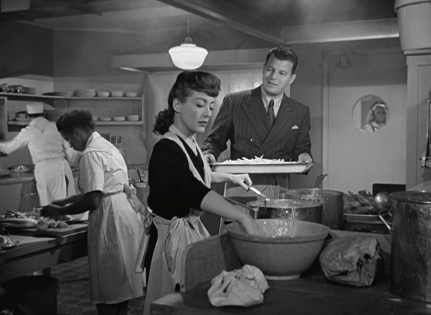 1945. Screen shot from 'Mildred Pierce' with Butterfly McQueen and Jack Carson.