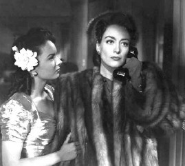 Suffering in fur: With Ann Blythe in 1945's 'Mildred Pierce.'