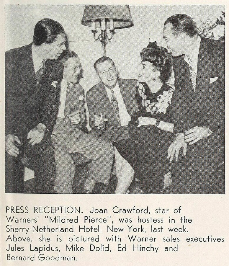1945. At the Sherry-Netherland with Warners publicity men.
