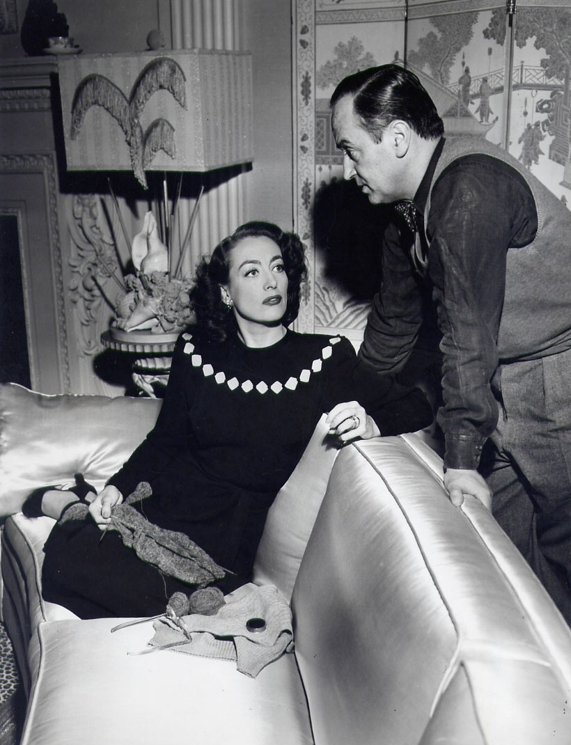 1946. On the set of 'Humoresque' with director Jean Negulesco.