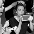 1947. Makeup and hair on the set of 'Daisy Kenyon.'