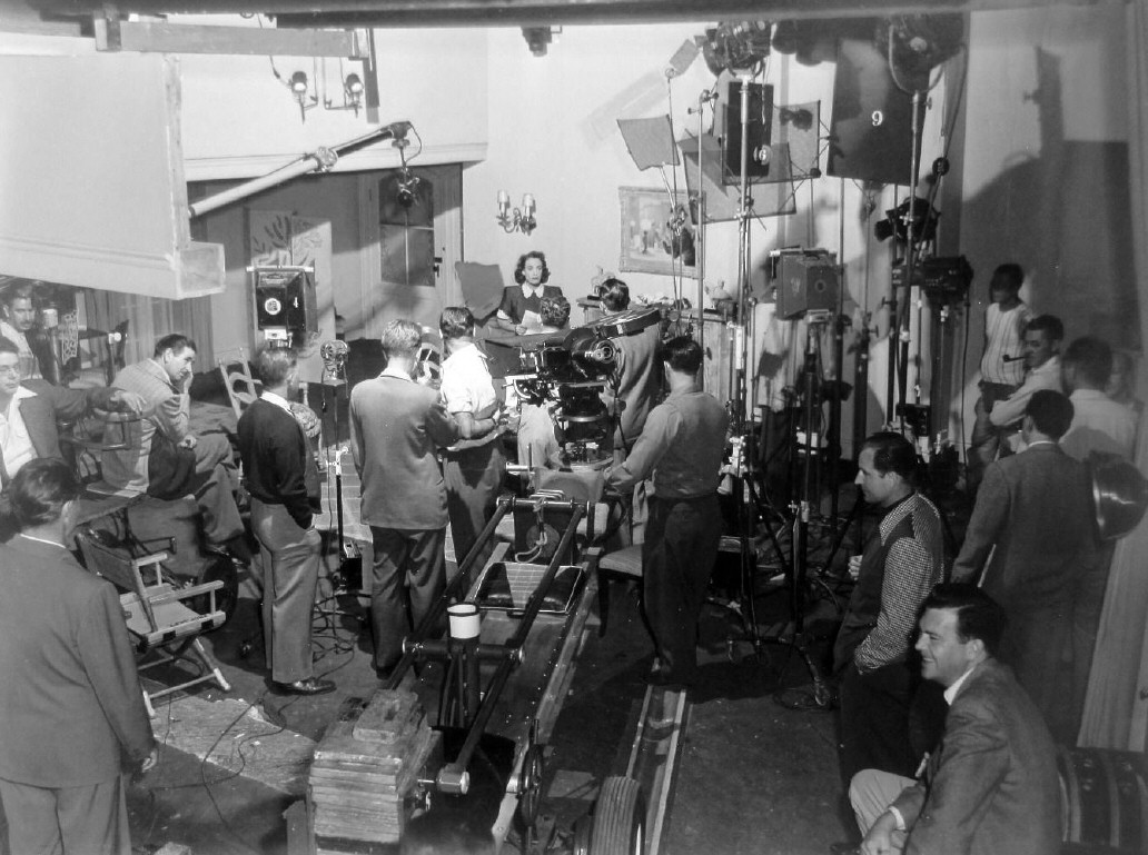 1947. On the set of 'Daisy Kenyon.' Long shot of photo above.