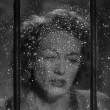 1947. Two 'Possessed' screen shots with rainy window.