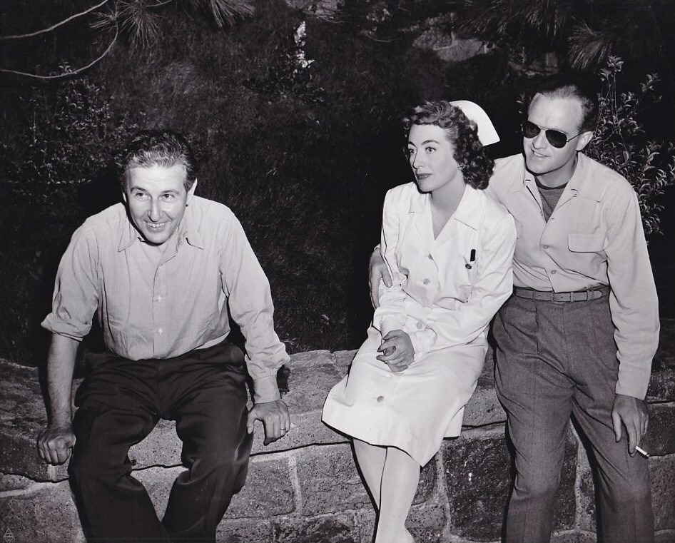 1947. On the set of 'Possessed' with director Bernhardt, left, and Van Heflin.