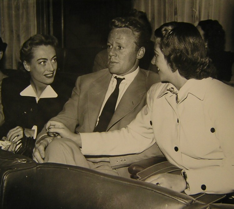 1947. At a press preview for 'Possessed,' with Van and Evie Johnson.