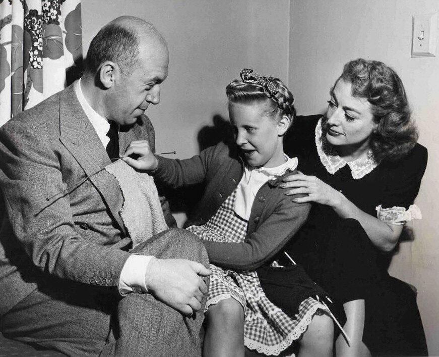 With director Preminger and daughter Tina on the 'Daisy Kenyon' set.