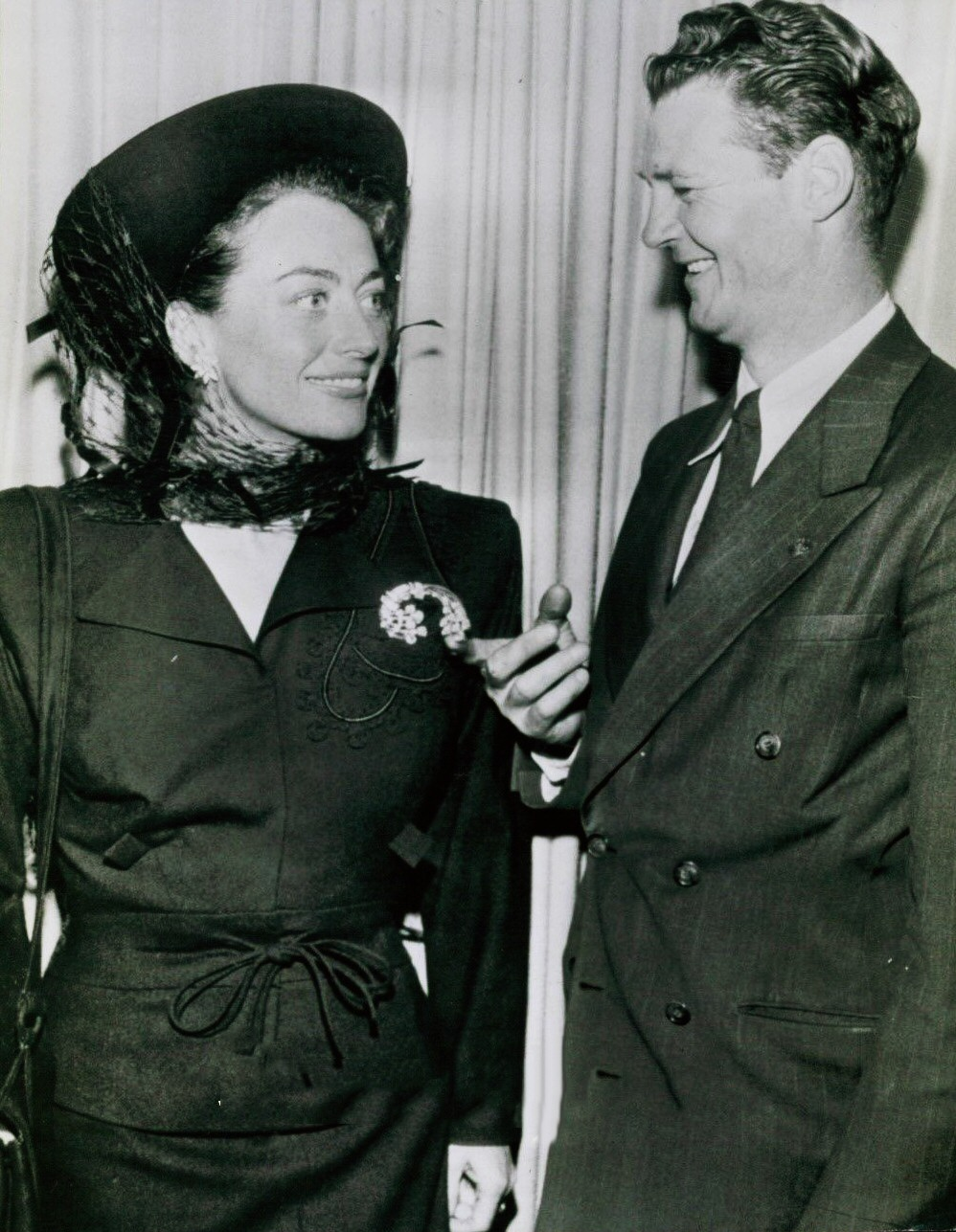 May 1948. With the detective who returned Joan's $50,000 brooch lost at Slapsy Maxie's.