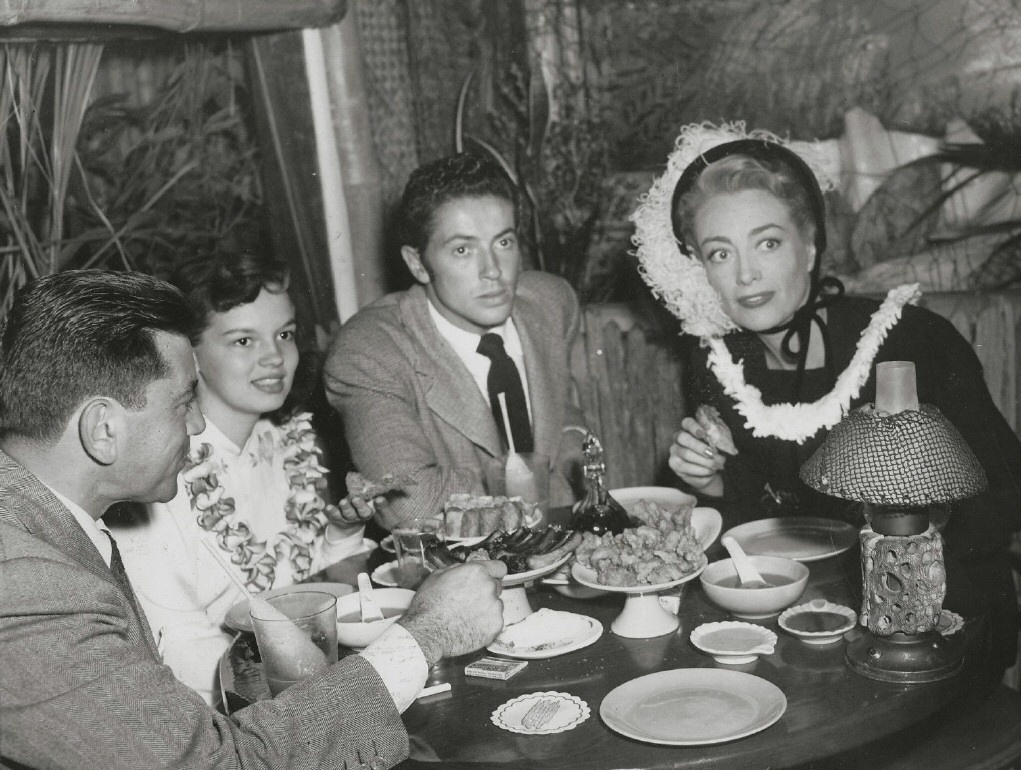 1948 at Don the Beachcomber with director Irving Reis, goddaughter Joan Evans, and Farley Granger.