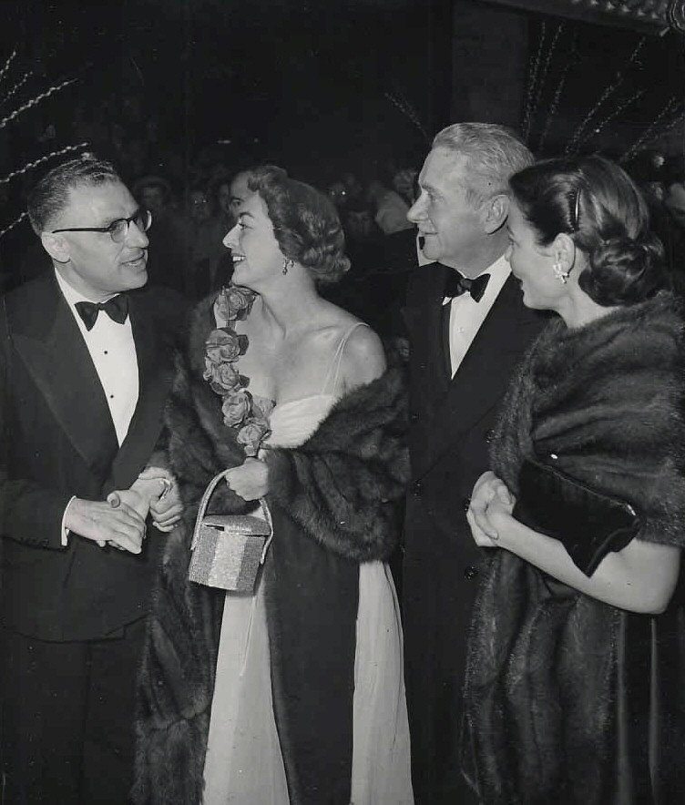 1949. At a club with George Cukor, Clifton Webb, and Gene Tierney.