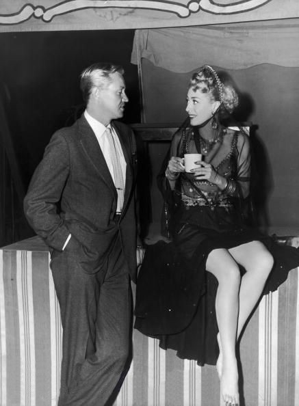 1949. On the set of 'Flamingo Road,' with David Brian.