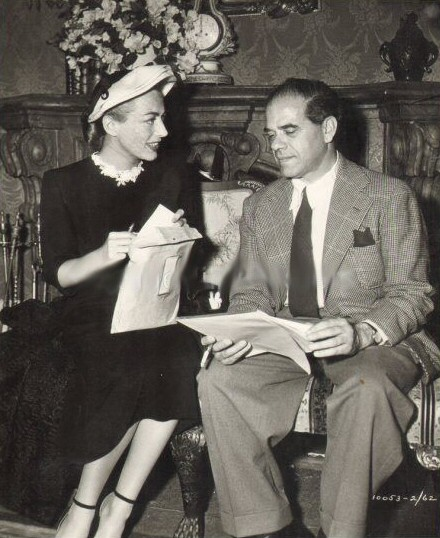 1949. With Frank Capra on the set of his 'Riding High.'