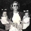 1949. With twins Cathy and Cynthia.