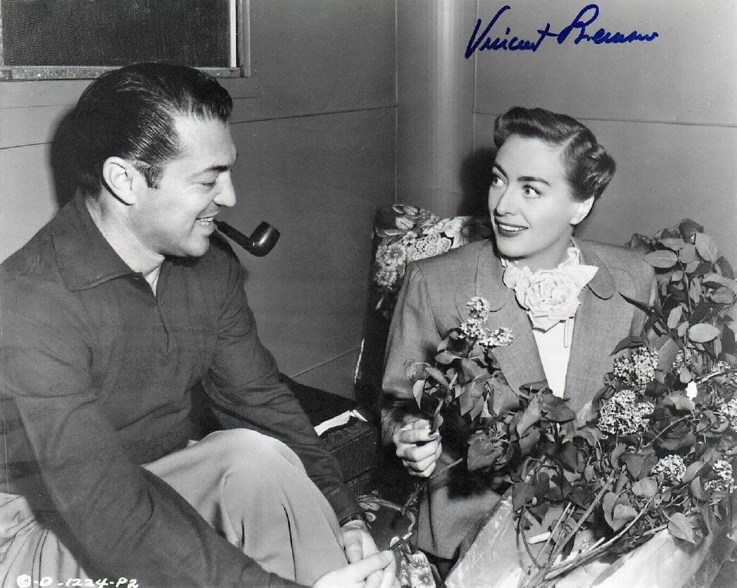 1950. On the set of 'Harriet Craig' with director Vincent Sherman.