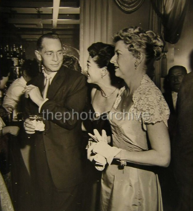 1954. With ex-husband Franchot Tone and Betty Furness.