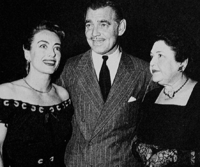 Circa 1949. With Clark Gable and Louella Parsons at the Brown Derby.