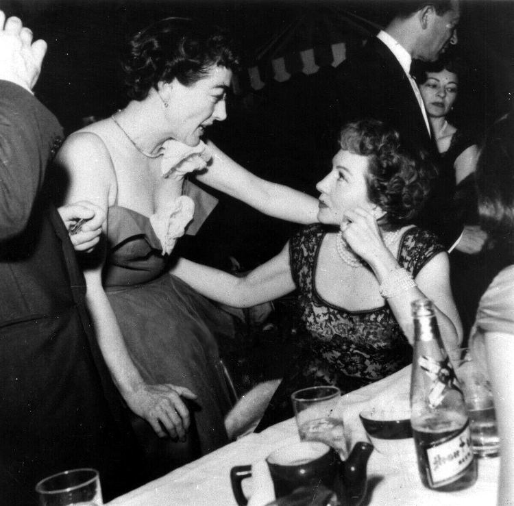 April 1954 with Claudette Colbert at Romanoff's.