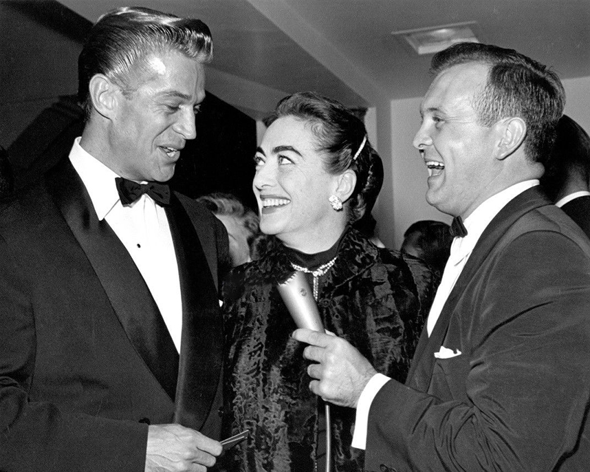 1954. With George Nader, left, and Johnny Grant.