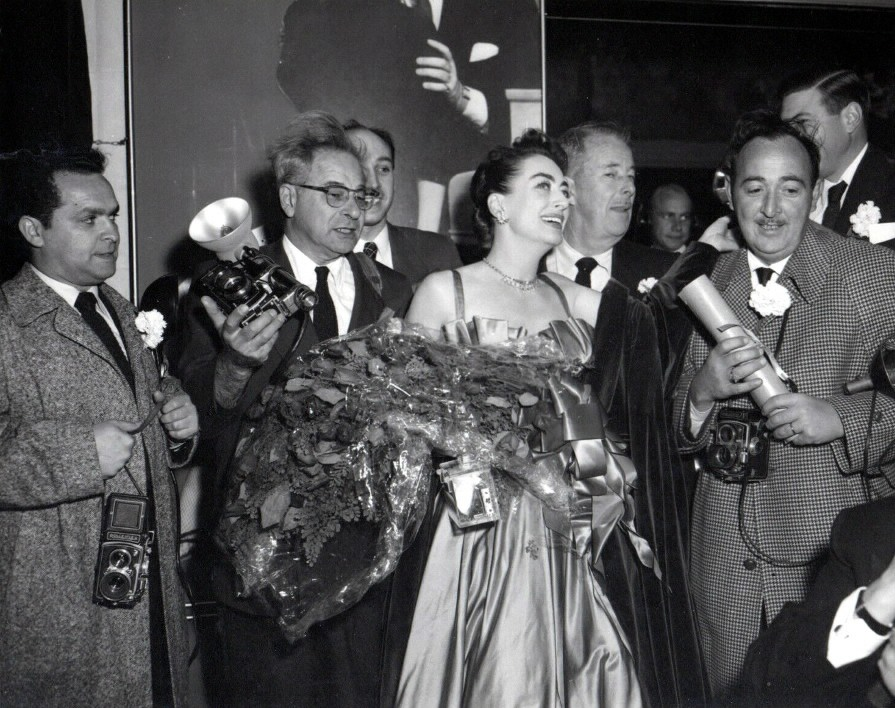October 1953 with press photogs at 'Torch Song' premiere party.