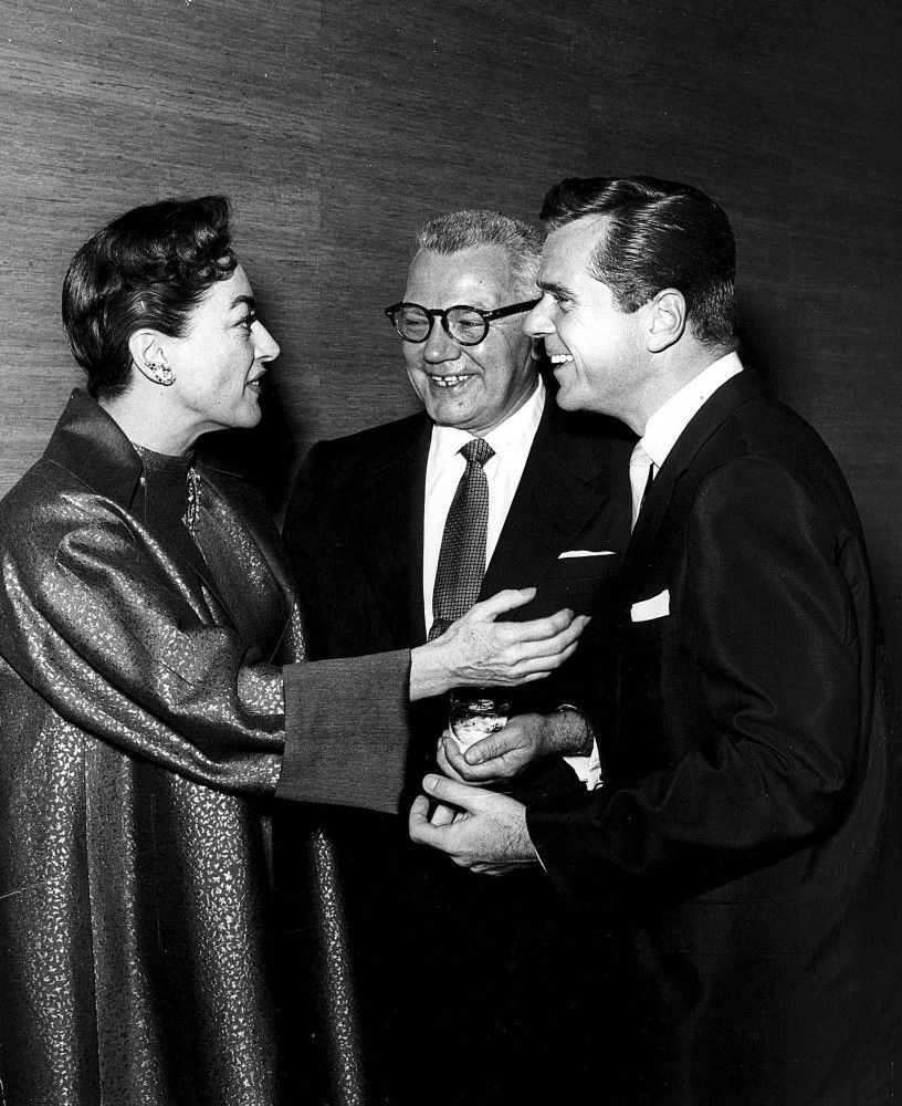 October 1955. At a Hollywood event with husband Al Steele, center, and Jackie Cooper.
