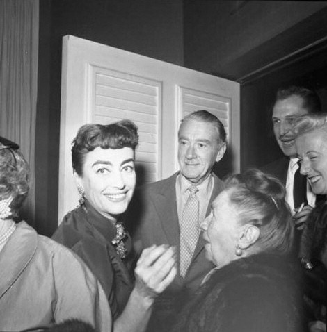 1954. With Clifton Webb (and Vincent Price in doorway).