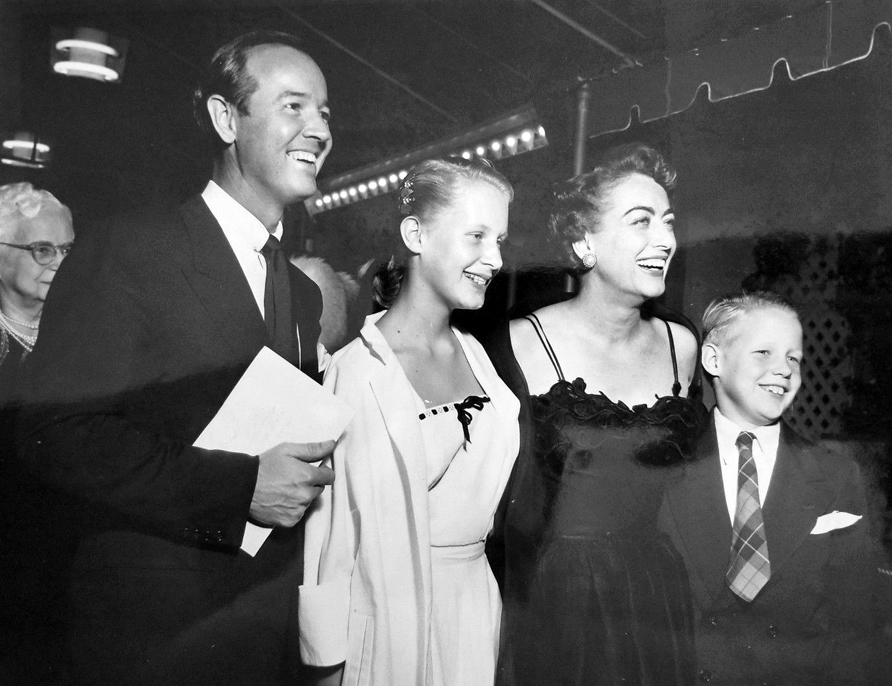 1951. With Earl Blackwell, Christina, and Christopher.