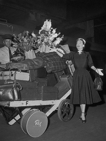 August 2, 1952. Joan and luggage at Grand Central Station.