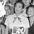 August 7, 1952. Joan and fans at the premiere of 'Sudden Fear.'