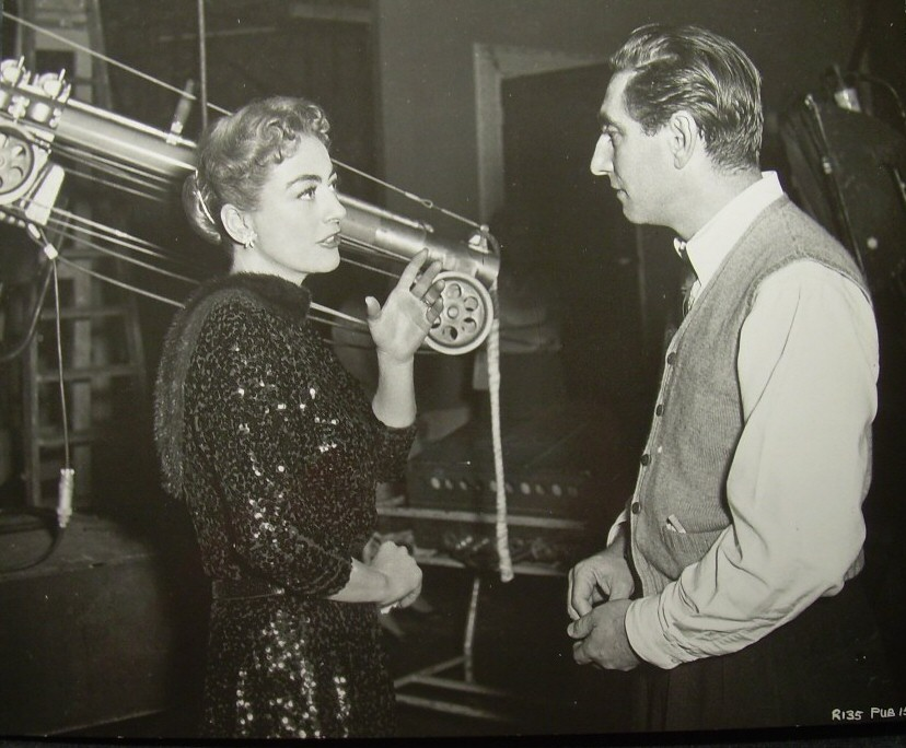 1957. On the set of 'Esther Costello' with director David Miller.