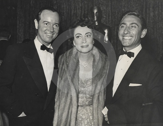 March 19, 1953, at the Pantages Theatre for the first televised Oscars. With Earl Blackwell, left, and director David Miller.