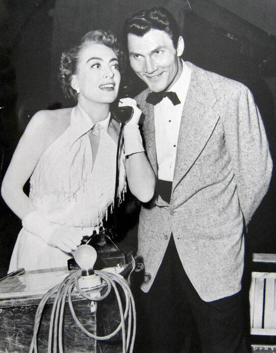 1952. On the set of 'Sudden Fear' with Jack Palance.