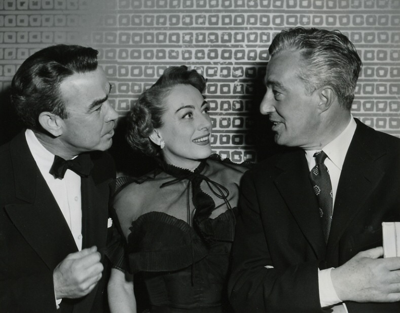 1952. With Mel Dinelli, left, and director Vittorio De Sica.