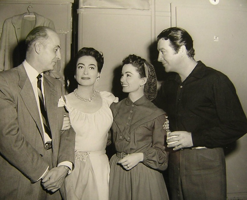 1953. On the set of 'All the Brothers Were Valiant' with director Richard Thorpe, Ann Blyth, and Robert Taylor.