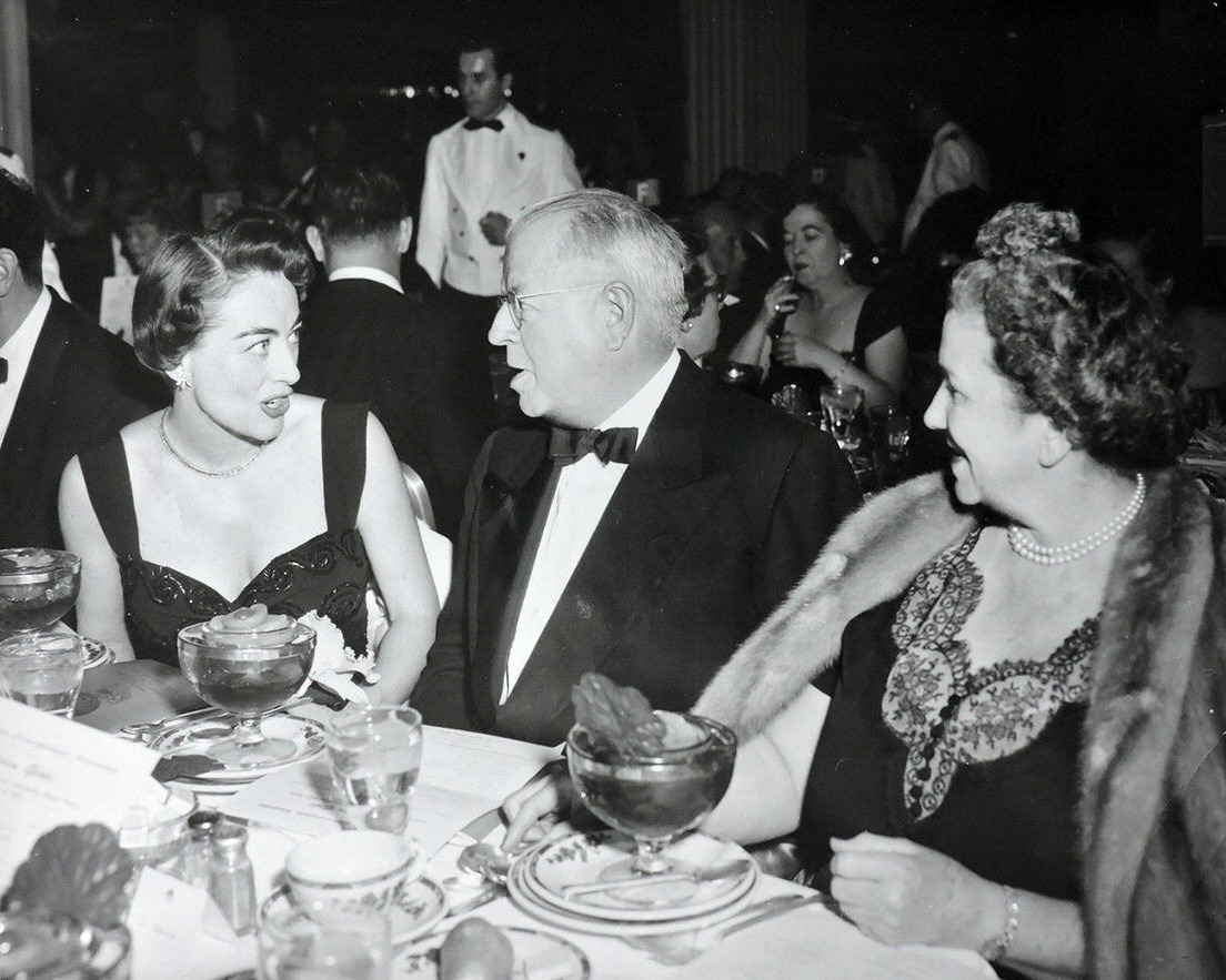 March 1953. At an awards dinner with Paramount head Frank Freeman and wife.