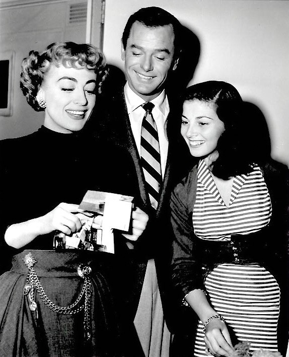 1953. On the set of 'Torch Song.' With Gig Young and Pier Angeli.