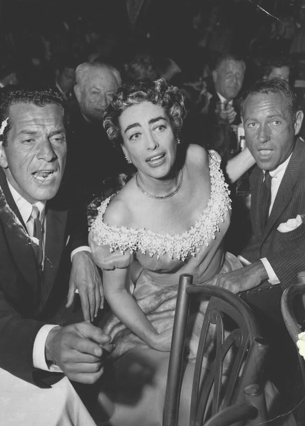 1953. At Mocambo with Jennings Lang, left.