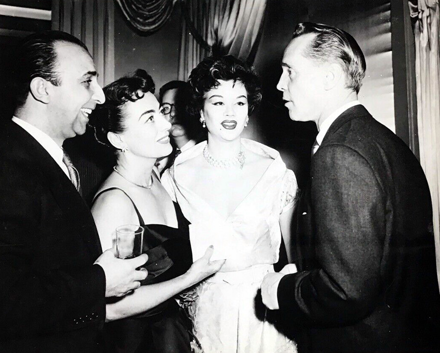 1953. At NYC's Harwyn Club with ex-husband Franchot Tone (right).