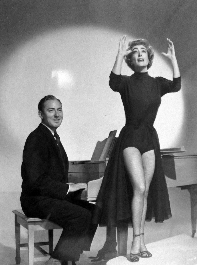 1953. 'Torch Song' publicity with Michael Wilding.