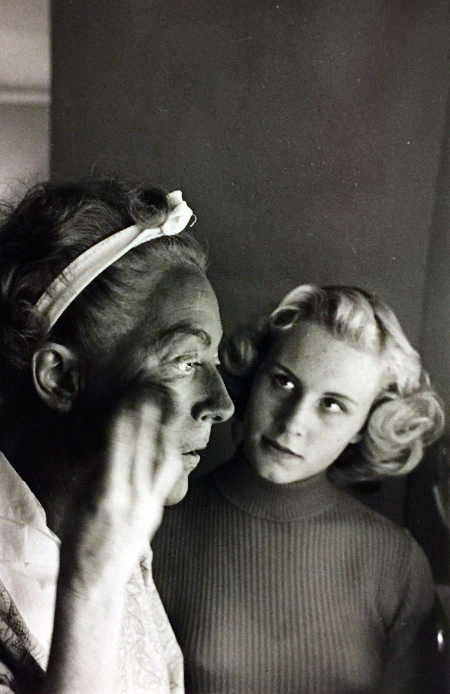 1953. Applying blackface on the set of 'Torch Song,' with Christina looking on. Shot by Sanford Roth.