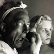 1953. Making up in blackface with Christina looking on. Shot by Sanford Roth.