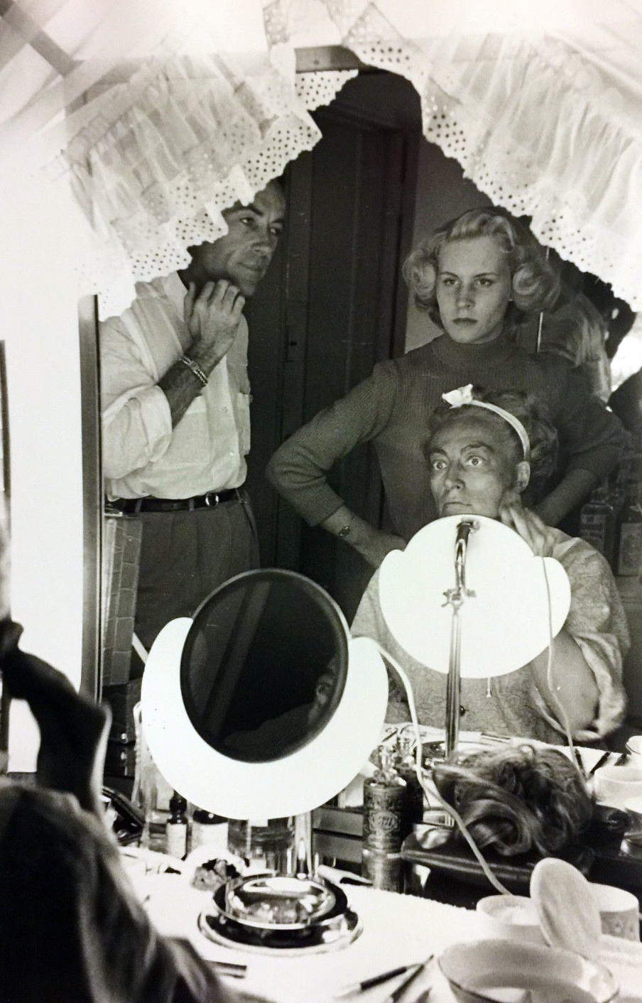 1953. Blackface on the set of 'Torch Song,' with director Walters and daughter Christina looking on.