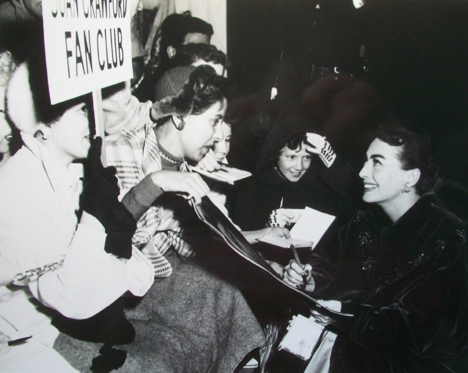 November 1953. With fan-club members at the premiere of 'Torch Song.'