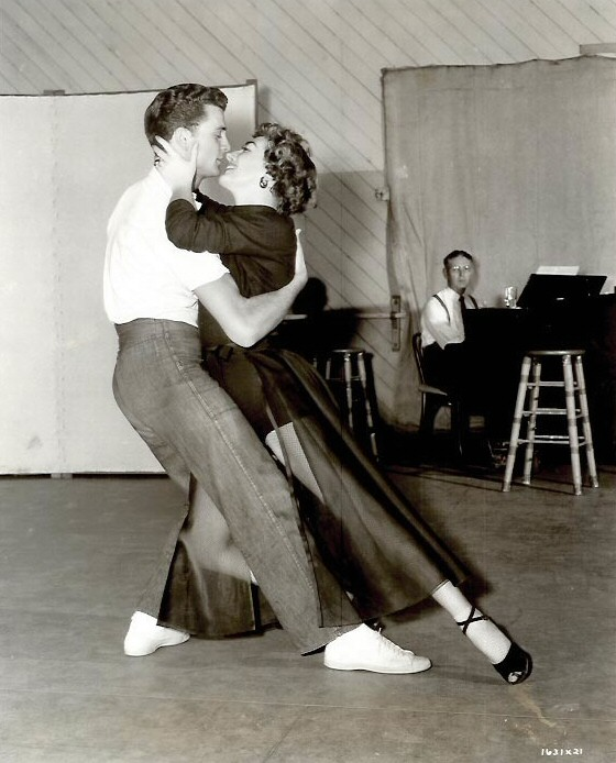 1953. On the set of 'Torch Song' with dancer Mark Wilder.